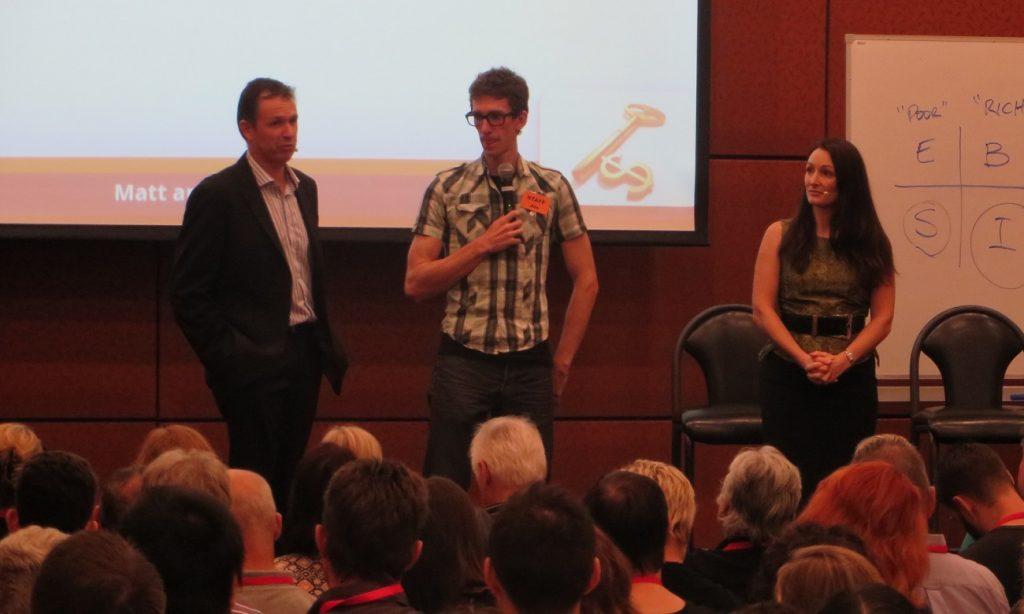 Matt and Liz Raad mentor Joe Burrill at live buy sell website training event