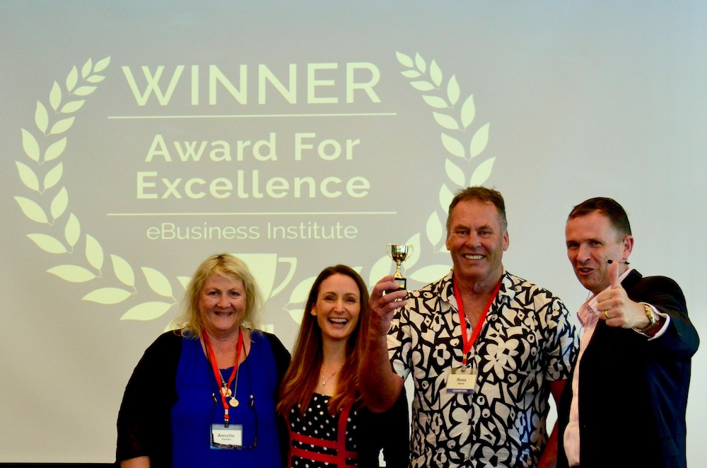 Annette Charles and Ross Davis winning digital marketing award from Matt Raad and Liz Raad