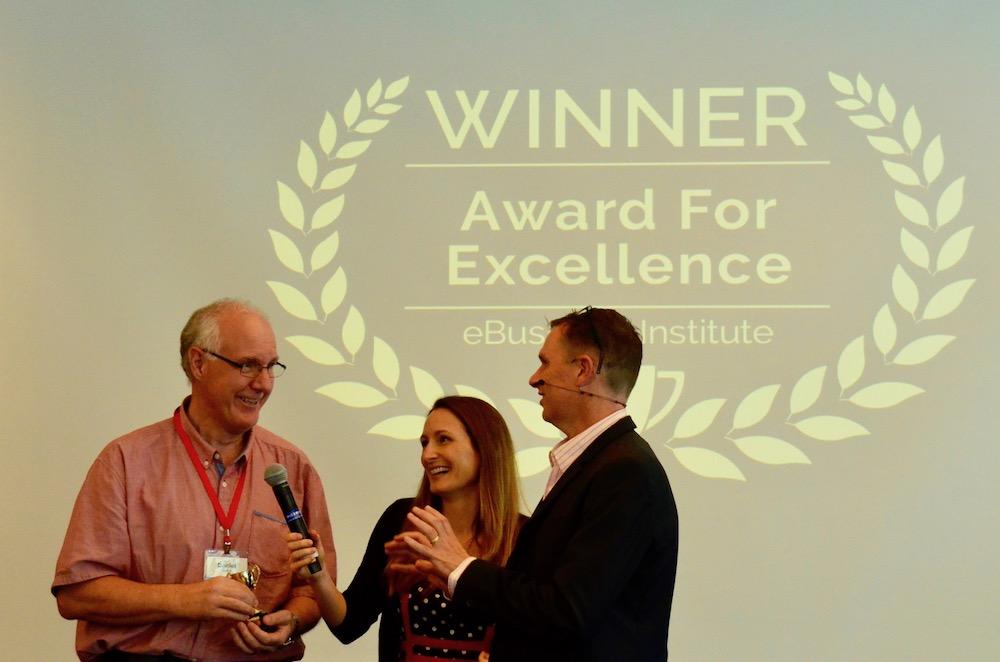 Daniel Quick winning digital marketing award from Matt Raad and Liz Raad
